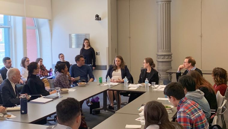 Candid shot of Furman Center representatives speaking at a NYU Wagner student event.